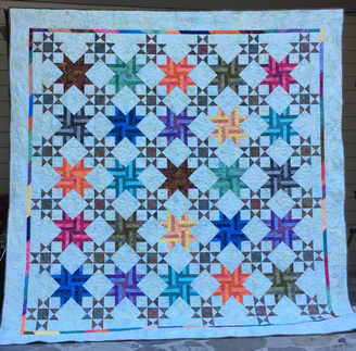 Blooming Stars raffle quilt